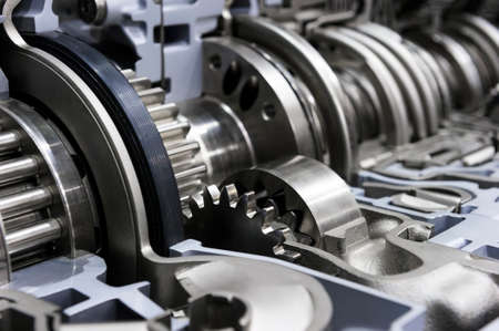 Gearbox cross-section, automotive transmission with sprocket and bearing mechanism for commercial trucks, SUV, cargo, and construction vehicles, selective focus