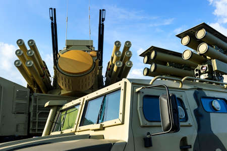 Military offroader vehicle with anti-tank guided missile system, multifunction weapon complex with rocket launcher, heavy machine gun and mobile antiaircraft radar on background