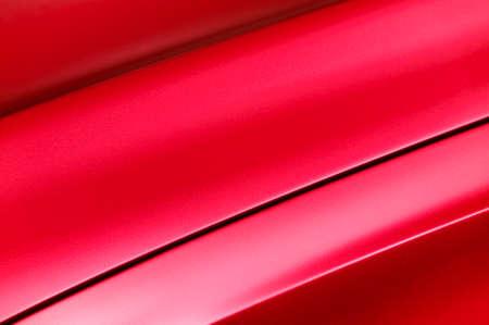 Fragment de rouge carrosserie de la voiture de l'acier, véhicule d'argent texture de revêtement de peinture, mise au point sélective, abstraite Banque d'images