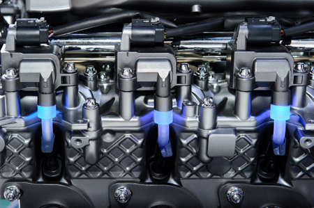 Engine with metal and chrome parts of the car motor with three blue lights Standard-Bild
