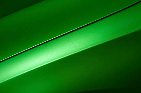 shiny: Surface of green sport sedan car, detail of metal hood and fender of vehicle bodywork Stock Photo