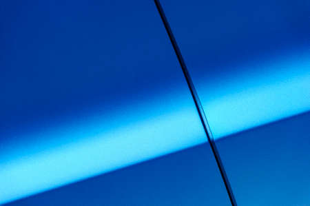 paint texture: Fragment of blue steel car bodywork, vehicle silver paint coating texture, selective focus, abstract