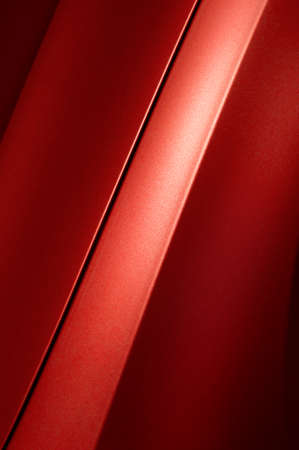 bodywork: Fragment of red steel car bodywork, vehicle silver paint coating texture, selective focus, abstract