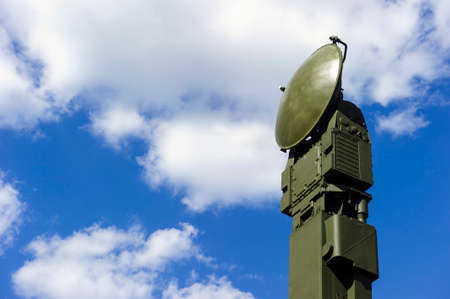 mighty: Air defense radar of military mobile mighty rocket launcher system of green color, modern army industry, white cloud and blue sky on background