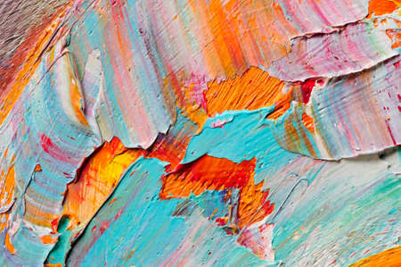 Artist's palette with mixed oil paints, macro, colorful stroke texture on canvas, studio shot, abstract art background