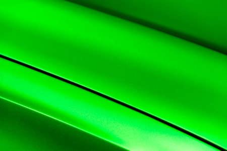 bodywork: Surface of green sport sedan car metal hood, part of vehicle bodywork, steel gradient line pattern