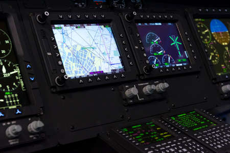 Control panel in military helicopter cockpit, copter dashboard with displays, dials, buttons, switches, faders, knobs, other toggle items, air force, modern aviation and aerospace industry