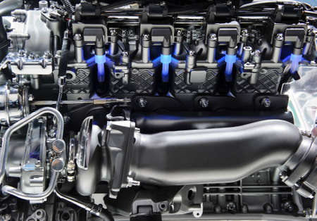 Powerful engine with metal, chrome, steel, plastic parts and blue lights of automobile race motor