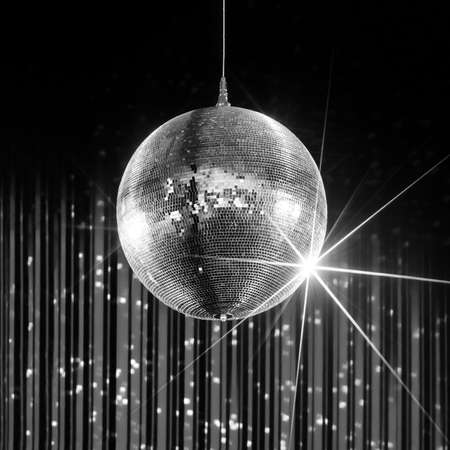 mirror ball: Party disco ball with stars in nightclub with striped walls lit by spotlight, nightlife entertainment industry, monochrome