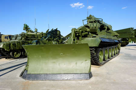 remover: Military obstacle remover, combat engineering machine moulboard, army special-purpose cleaning vehicle, heavy industry, white clouds and blue sky on background