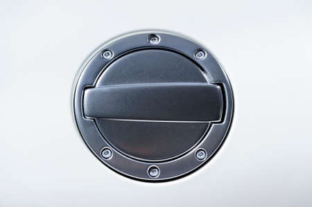 car gas: Fuel tank cover of racing car, gas filler cap of sport sedan automobile with white color bodywork, round metal object with screws, auto industry