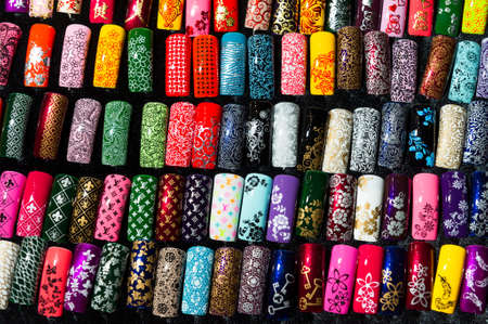 finger tip: Nail samples, big collection of fingernails painted in various color with different pattern, selective focus