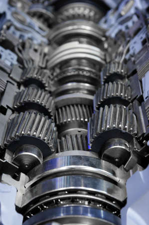 sprockets: Gearbox cross-section, engine industry, sprockets, cogwheels and bearings of automotive transmission for oversize trucks, SUV, cargo, commercial and construction vehicles, selective focus