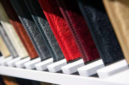 Fabric samples in row, upholstery and carpet textile examples for car interior Standard-Bild