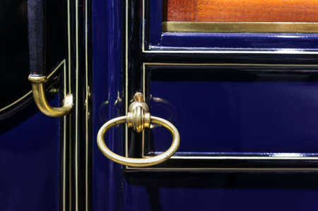 bodywork: Car handle of vintage vehicle door, retro design, detail of old comfortable automobile with dark blue metallic bodywork, selective focus Stock Photo