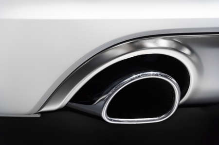bodywork: Shrome exhaust pipe of powerful sport car with white bodywork and grey shiny aluminum detail