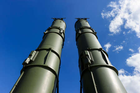 ballistic: Antiaircraft missile complex, military ballistic launcher with two big missiles ready to attack with blue sky and white clouds on background, modern army industry Stock Photo