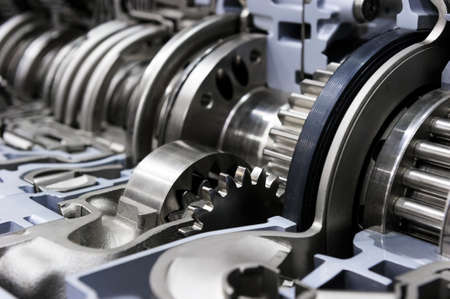 oversize: Gearbox cross-section, engine industry, sprockets, cogwheels and bearings of automotive transmission for oversize trucks, SUV, cargo, commercial and construction vehicles, selective focus