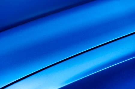 bodywork: Surface of blue sport sedan car metal hood, part of vehicle bodywork, steel gradient line pattern