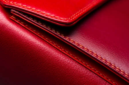 Red leather bag with pocket and stitches, womans accessories, fashion industry, macro shot, selective focus, abstraction Stock Photo