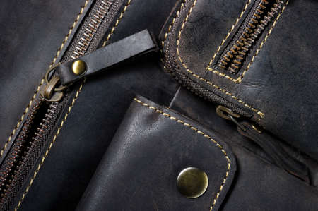 clutch cover: Leather bag with zipper, magnetic clasp on pocket and stitches, man accessories in vintage style, macro shot, selective focus