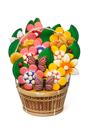 sweetmeats: Gingerbread cookies and candies in basket, colorful homemade sweet cakes in shape of flower, leaf, butterfly, ladybag and sweetmeats in pottle isolated on white, food industry