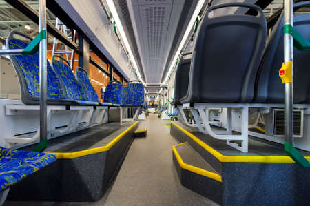 rapid steel: City transportation interior with blue seats in row