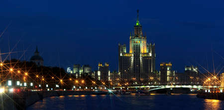 sickle: High-rise building in soviet style on embankment of Moscow River, Stalins empire architecture, evening summer panorama Stock Photo