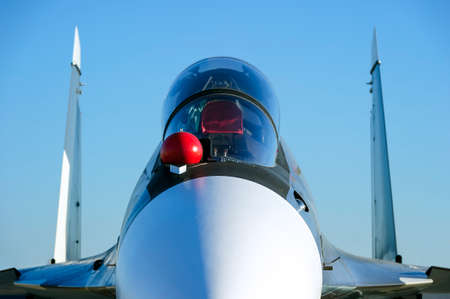 Fighter-bomber jet with empty bulletproof cockpit of military multifunction plane, fourth-generation aircraft, modern army industry, supersonic air force, blue sky on background, selective focus Standard-Bild