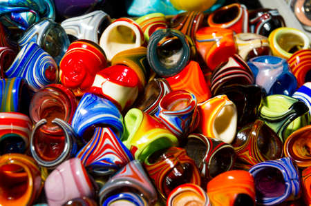 Jewelry, rings of bright colorful glass, female bijouterie accessory, selective focus, abstraction
