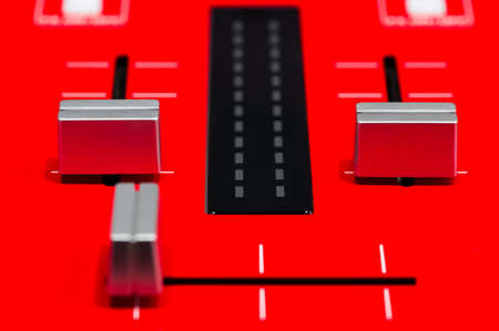 Red DJ mixer, sound and voice controlling equipment for professional disc jockey Lizenzfreie Bilder