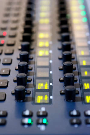 Sound mixer, professional audio mixing console with yellow, green, red lights and buttons