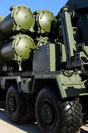 Heavy missile launcher on powerful army truck, rear view, modern military industry, antiaircraft forces, blue sky on background
