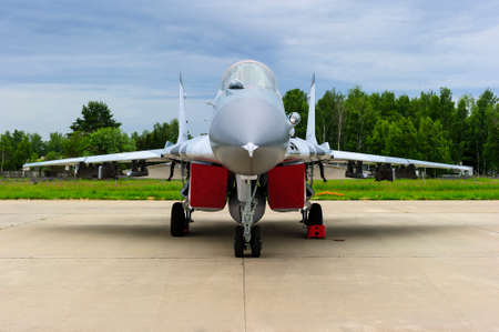 Fighter-bomber jet, military multifunction plane on airfield runway, modern army, aviation and aerospace industry, supersonic air force