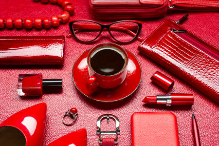 Red woman accessories, coffee, cosmetic, jewelry, gadget and other objects on a leather background, fashion industry, modern female concept, selective focus