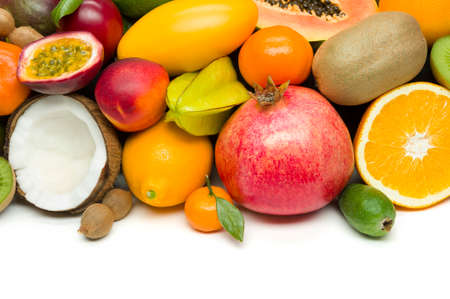 Exotic tropical fruits with slices, healthy food, vegetarian diet, white space for text
