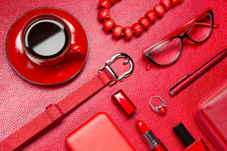 Red woman accessories, coffee, jewelry, cosmetic, gadget and other objects on a leather background, fashion industry, modern female concept