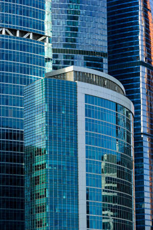 Skyscrapers, office buildings in business centre of city, modern glass architecture in commercial downtown, future design abstraction Standard-Bild - 119608991