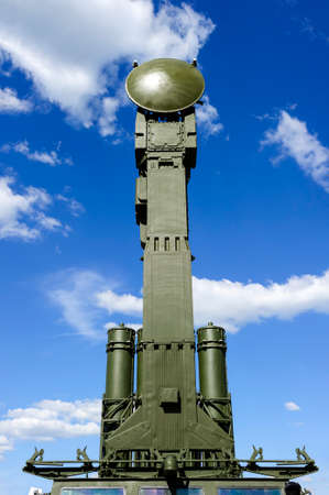 Air defense radar of military mobile mighty missile launcher system of green color, modern army industry, white cloud and blue sky on background Standard-Bild - 119608998