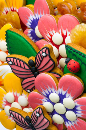 Gingerbread cookies for kids, colorful homemade sweet cakes in shape of flower, leaf, butterfly, ladybug, food industry, selective focus Standard-Bild - 119609005
