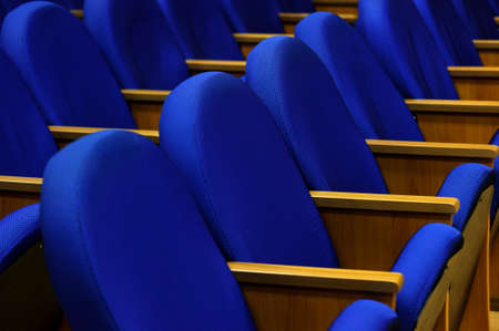 Seats in conference room for business meeting, rows of blue textile comfortable chairs in empty hall, selective focus Standard-Bild - 119609008