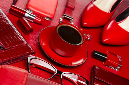 Woman red accessories with coffee, cosmetic, jewelry, gadget and other luxury objects on leather background, fashion industry, modern female concept, selective focus Standard-Bild - 119609009