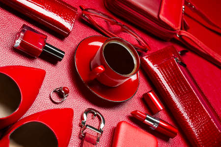 Woman red accessories with coffee, cosmetic, jewelry, gadget and other luxury objects on leather background, fashion industry, modern female concept, selective focus Standard-Bild - 119609010