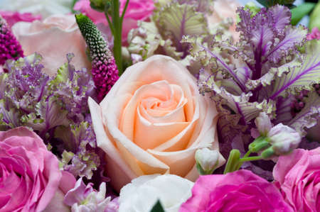 Flower bouquet, bunch of peach and pink roses, white lisianthus, red veronica spicata or garden speedwell, springtime concept, selective focus, macro shot Standard-Bild - 119609013