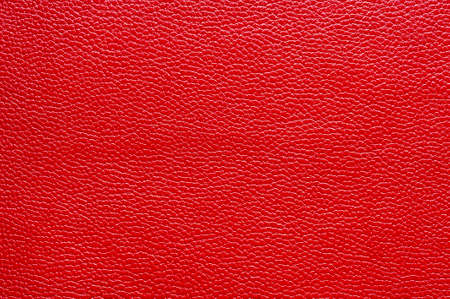Red leather for manufacturing of shoes, clothes, bags and other fashion accessories, high quality natural seamless material sample, textured background, top view