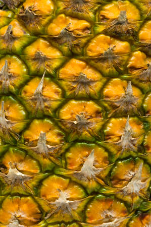 Pineapple peel background, detail of tropical fruit skin, natural abstract texture, macro shot