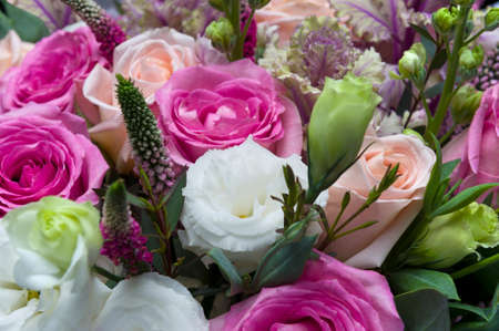 Flower bouquet, bunch of pink and peach roses, white lisianthus, red veronica spicata or garden speedwell and green eucalyptus, springtime concept, selective focus Stok Fotoğraf