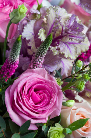 Bouquet of roses with white lisianthus, pink veronica spicata or garden speedwell and green eucalyptus, springtime concept, selective focus