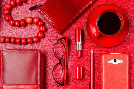 Woman red accessories with coffee, jewelry, cosmetic, gadget and other luxury objects on leather background, fashion industry, modern female concept Stok Fotoğraf