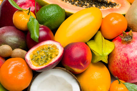 Exotic tropical fruits with slices, healthy food, vegetarian diet nutrition, selective focus